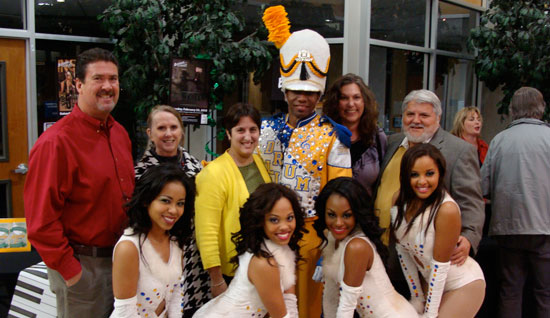 Authentic Custom Homes, Silver Sponsors for Drumline Live, greeted cast members Brian Snell (Drum Major) and the Drumline Live Dancers immediately following Saturday's production. From left to right are John Froetschel, Tricia Peña, Sally Peña, Teri Froetschel and Israel Peña. Following their performance, the cast of Drumline Live led the audience to the lobby where the artists had an opportunity to meet ticket holders and the sponsors for this event. Authentic Custom Homes' sponsorship provided funding for 1,000 students to attend a special school program held earlier that day by Drumline Live.